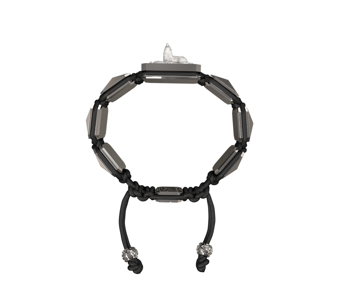 Selfmade bracelet with ceramic and sculpture finished in a Platinum effect complemented with a black coloured cord.