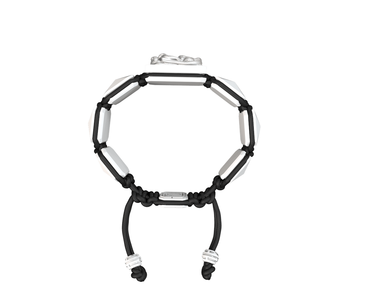 I Quit bracelet with white ceramic and sculpture finished in a Platinum effect complemented with a black coloured cord.