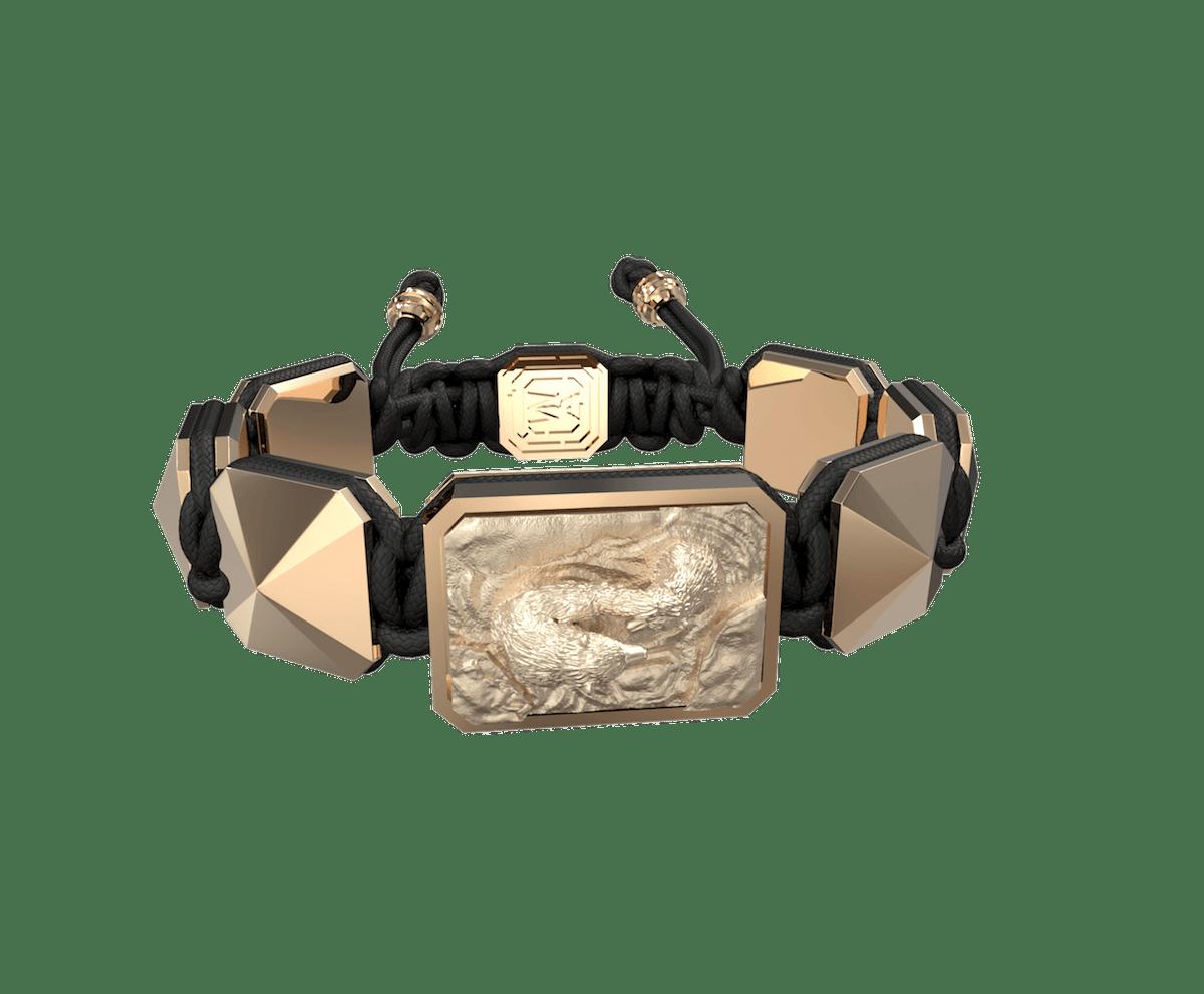 Pulsera Proud Of You con cerámica y escultura acabadas en Oro Rosa de 18k. Hilo negro.
