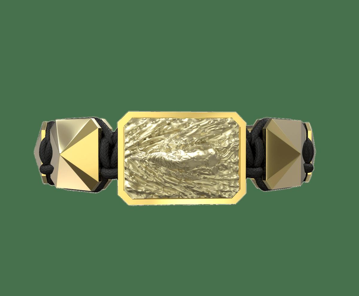 Pulsera I'm Different con cerámica y escultura acabadas en Oro Amarillo de 18k. Hilo negro.
