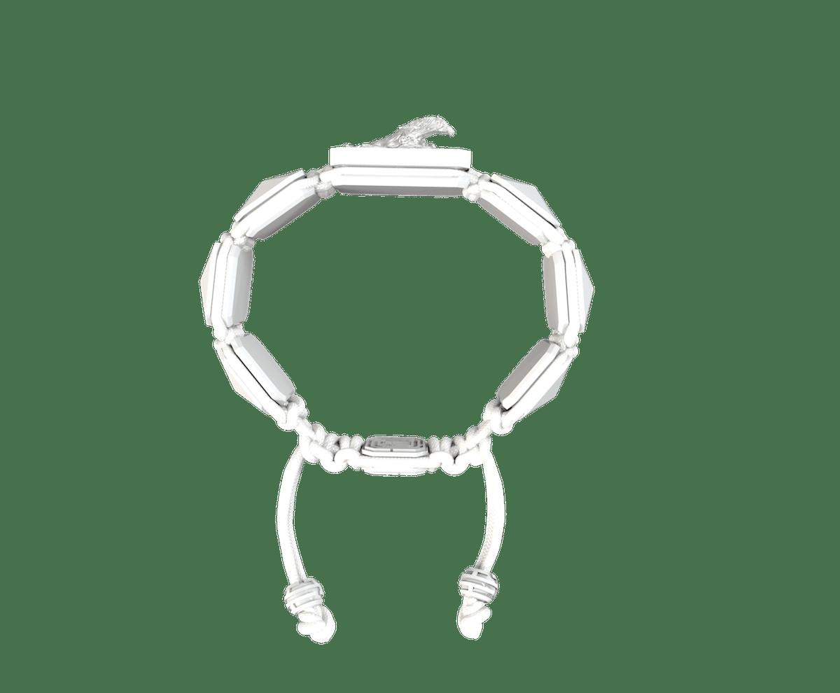 Pulsera I'm Different con cerámica blanca y escultura acabada en efecto Platino. Hilo blanco.