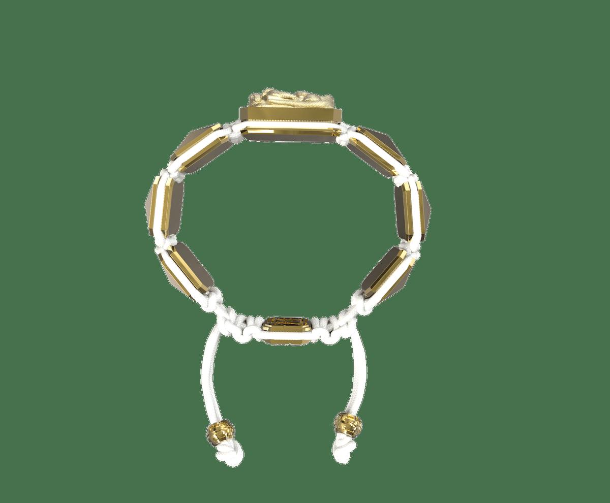Pulsera I Quit con cerámica y escultura acabadas en Oro Amarillo de 18k. Hilo blanco.