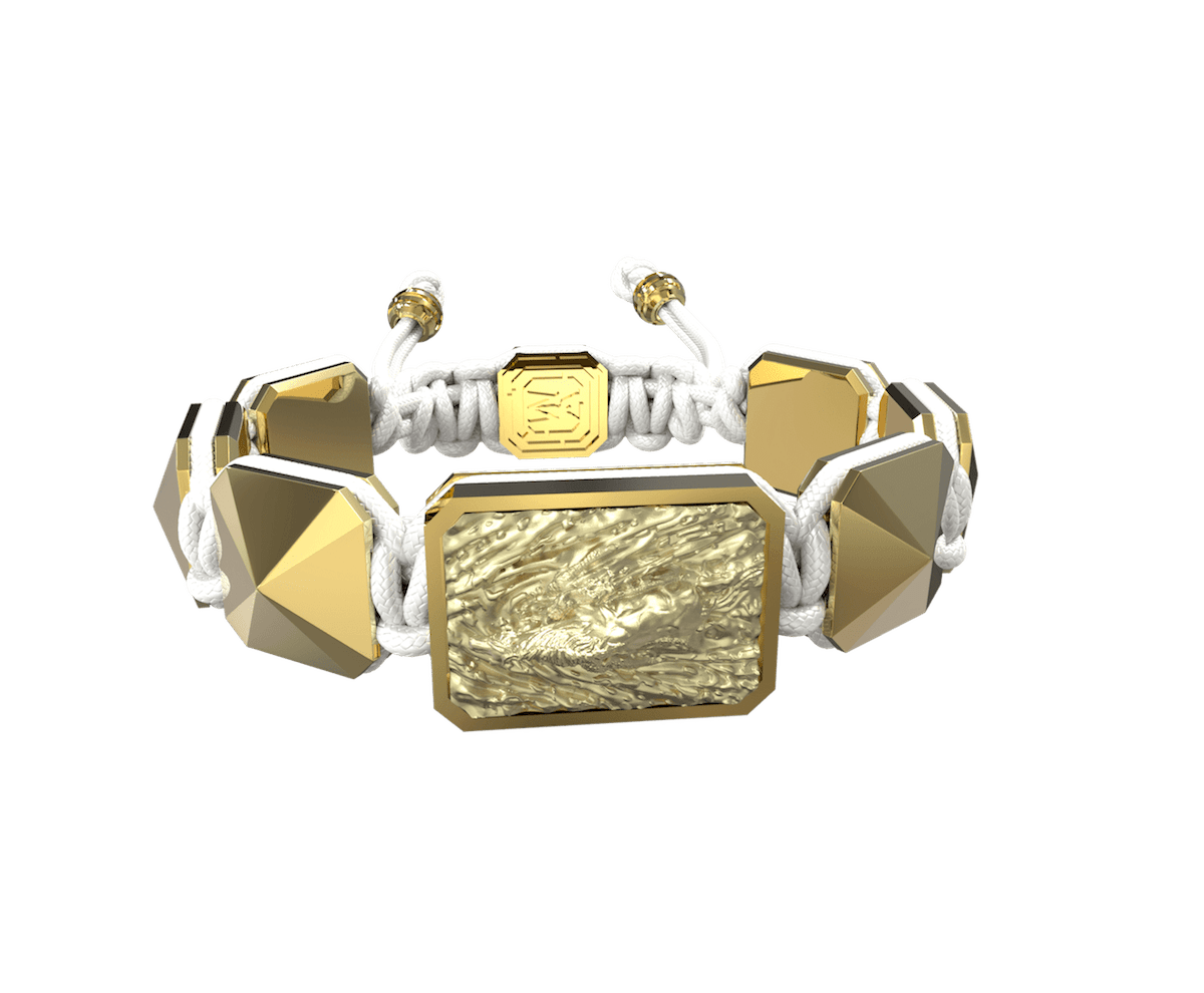 Pulsera I'm Different con cerámica y escultura acabadas en Oro Amarillo de 18k. Hilo blanco.