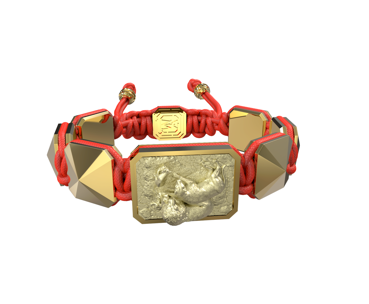 My Family First bracelet with ceramic and sculpture finished in 18k Yellow Gold complemented with a red coloured cord.