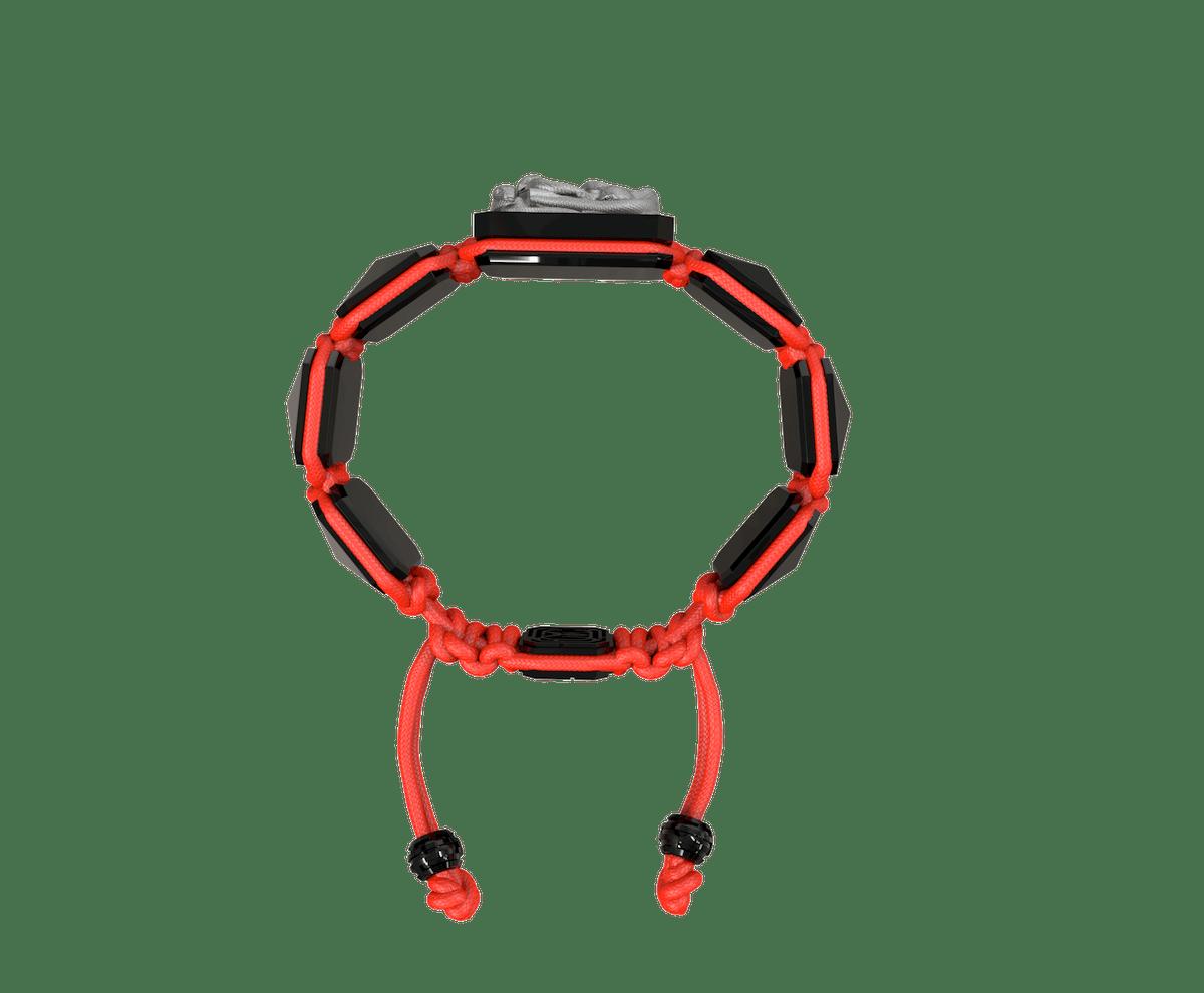 Pulsera I Quit con cerámica negra y escultura acabada en color antracita. Hilo rojo.