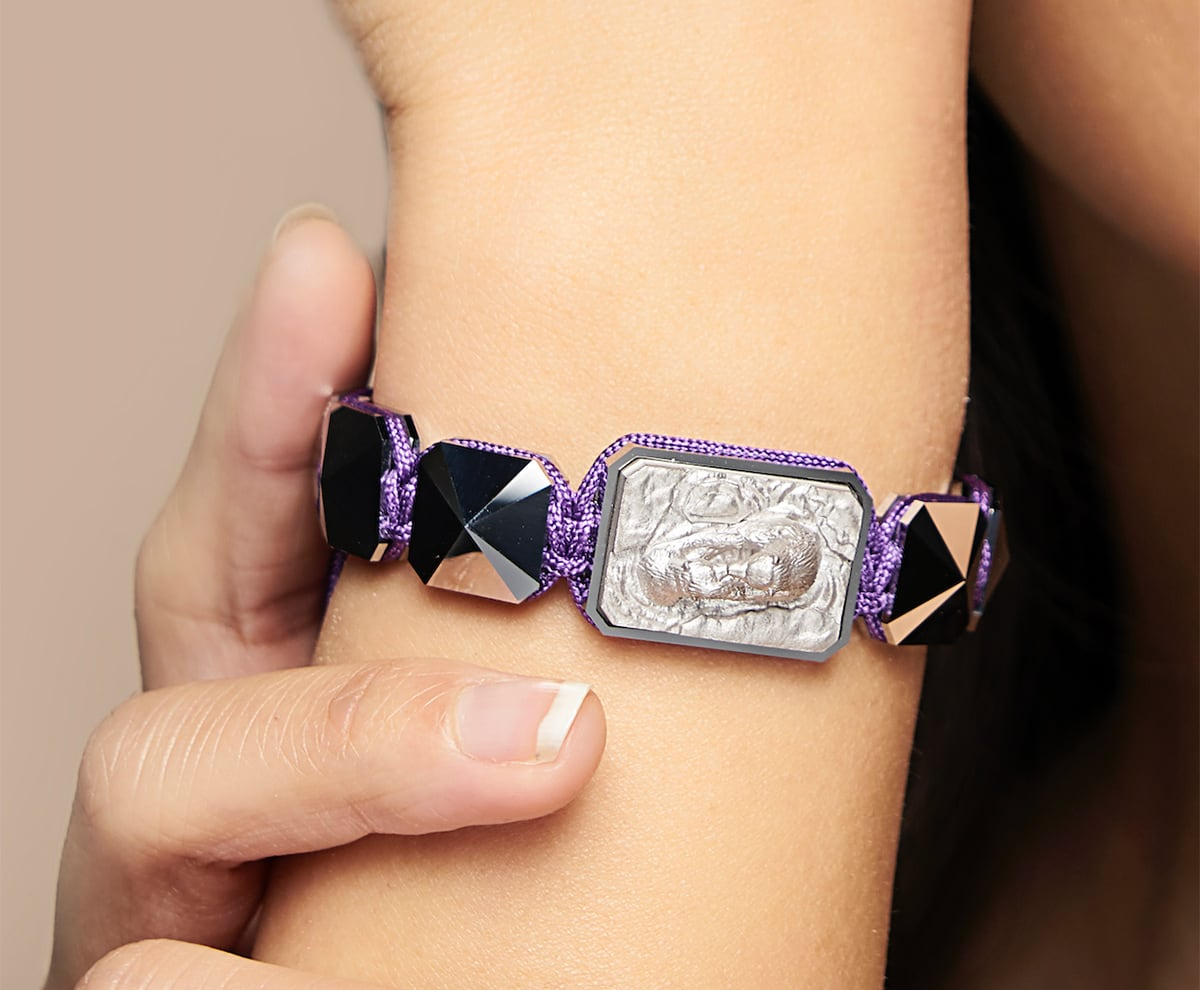 I Love My Baby bracelet with ceramic and sculpture finished in a Platinum effect complemented with a violet coloured cord.