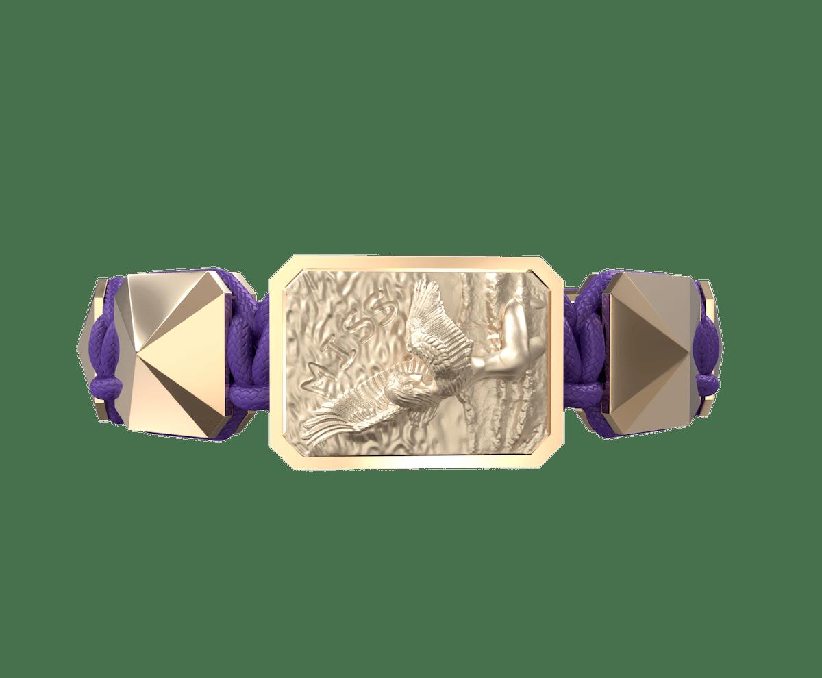 Pulsera Miss You con cerámica y escultura acabadas en Oro Rosa de 18k. Hilo violeta.