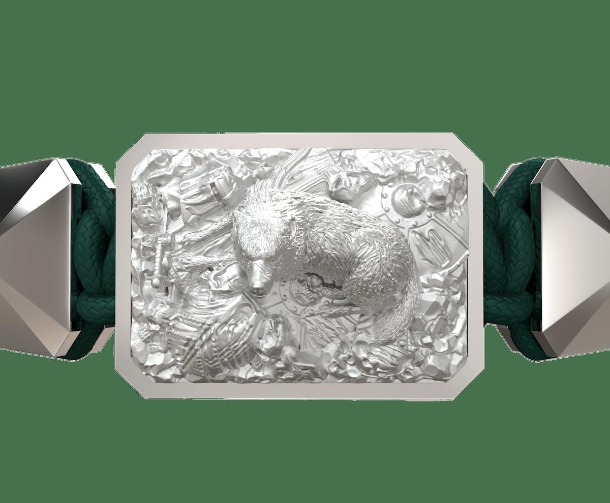 Pulsera Selfmade con cerámica y escultura acabadas en efecto Platino. Hilo verde oscuro.