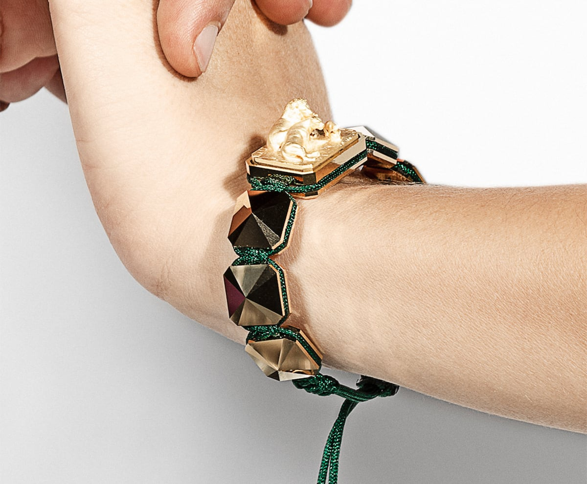 Miss You bracelet with ceramic and sculpture finished in 18k Yellow Gold complemented with a green coloured cord.
