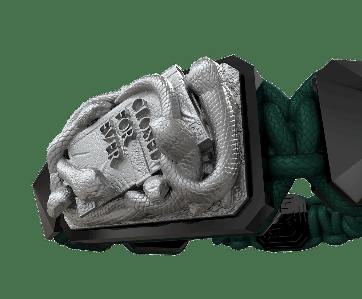 Pulsera I Quit con cerámica negra y escultura acabada en color antracita. Hilo verde oscuro.