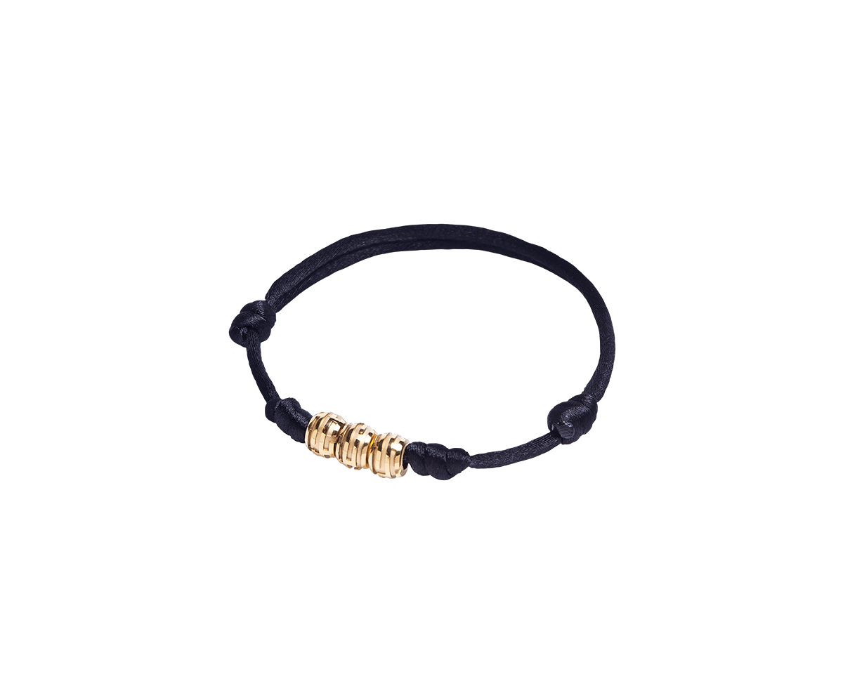 Maze Earth Bracelet finished in Yellow Gold. Carved in ceramics. Black thread.