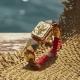 Pulsera I Love Me con cerámica y escultura acabadas en Oro Amarillo de 18k. Hilo rojo.