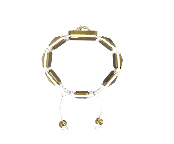 Shop I Love Me bracelet with ceramic and sculpture finished in 18k Yellow Gold complemented with a white coloured cord.