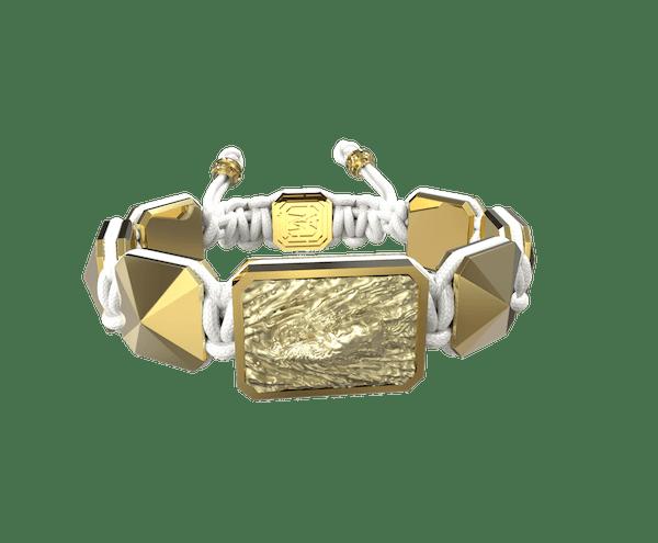 Comprar Pulsera I'm Different con cerámica y escultura acabadas en Oro Amarillo de 18k. Hilo blanco.