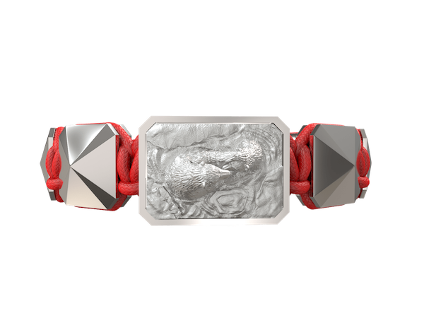 Shop Proud Of You bracelet with ceramic and sculpture finished in a Platinum effect complemented with a red coloured cord.