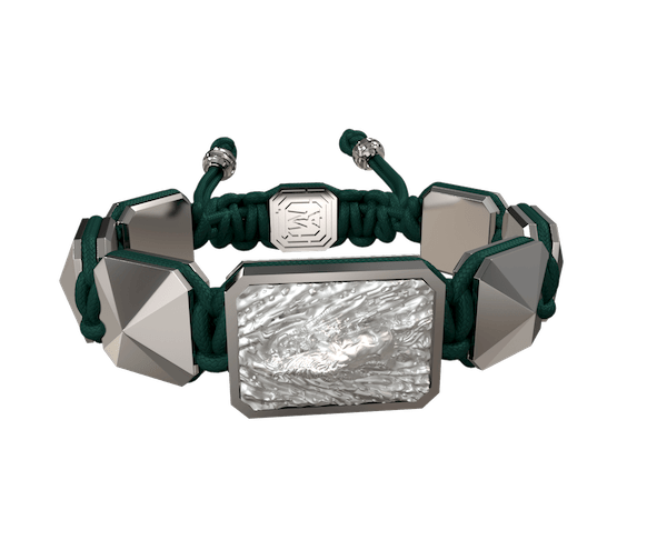 Shop I'm Different bracelet with ceramic and sculpture finished in a Platinum effect complemented with a dark green coloured cord.