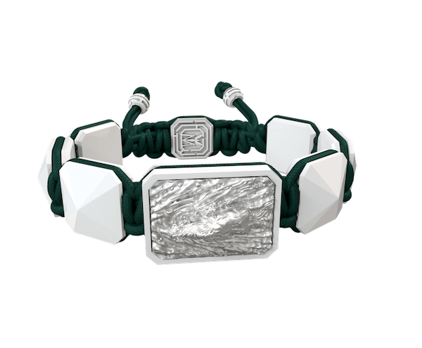 Shop I'm Different bracelet with white ceramic and sculpture finished in a Platinum effect complemented with a dark green coloured cord.