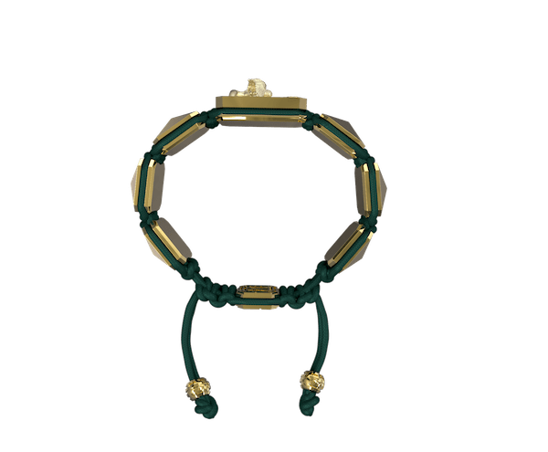 Shop Miss You bracelet with ceramic and sculpture finished in 18k Yellow Gold complemented with a green coloured cord.