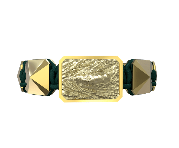Shop I'm Different bracelet with ceramic and sculpture finished in 18k Yellow Gold complemented with a green coloured cord.